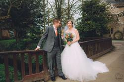 wedding photographers devon bride and groom on bridge.jpg