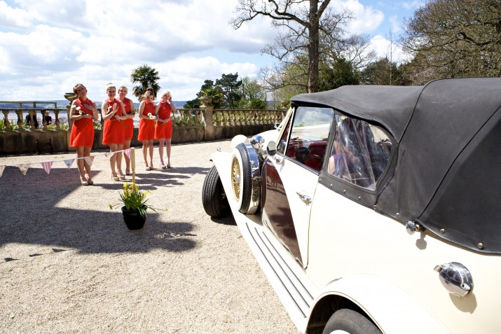 Wedding Photographer Devon wedding car and bridesmaids.jpg
