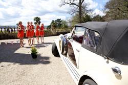 Wedding Photographer Devon wedding car and bridesmaids.jpg