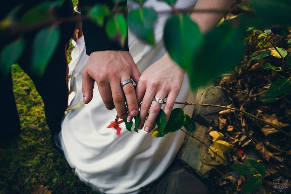 wedding photographers devon hands rings.jpg