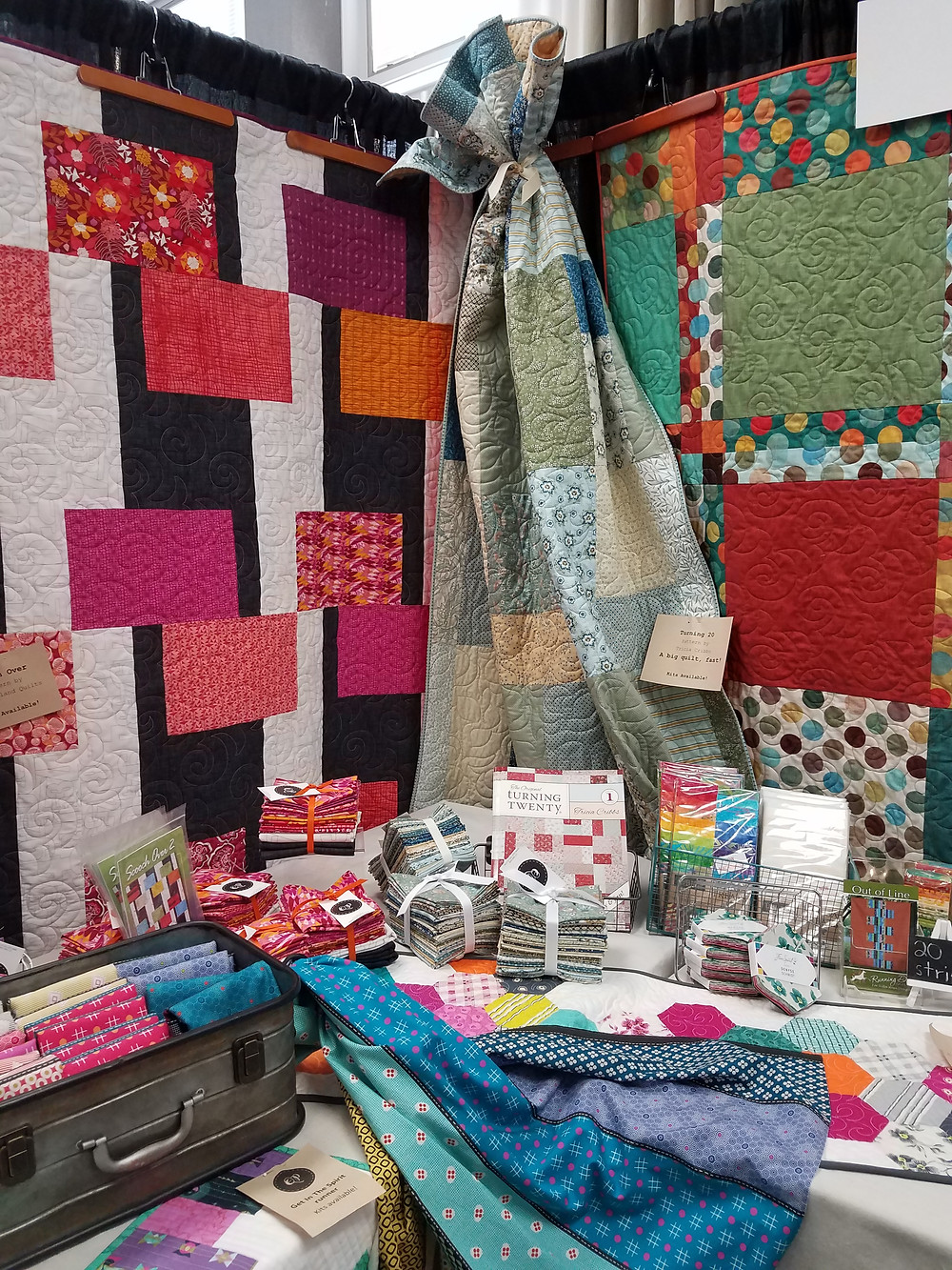 Picture of the Quilts Plus booth at the Indiana Heritage Quilt Show in Bloomington