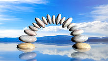 3D rendering of balancing stones forming an arch in water with blue sky and peaceful landscape..jpg