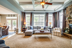 stone fireplace, custom curtains, swivel chairs, coffered ceiling