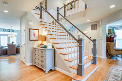 waterfall staircase, open floor plan, light hardwoods