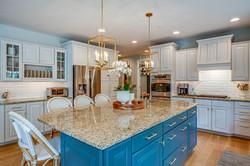bistro stools, transitional kitchen, kitchen renovation, blue kitchen island, gold pendants