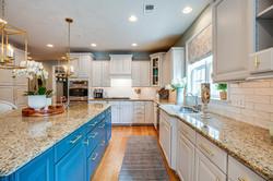 transitional kitchen, kitchen renovation, blue kitchen island, gold pendants