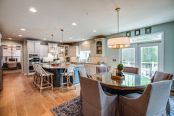 transitional kitchen, kitchen renovation, blue kitchen island, gold pendants, breakfast room, round