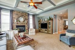 stone fireplace, custom curtains, swivel chairs