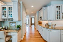 wine bar, white backsplash, off white cabinets, kitchen renovation
