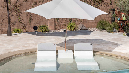 Pool Chairs on ledge w umbrella touched