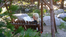 Pine Rose reading book by stream.jpg