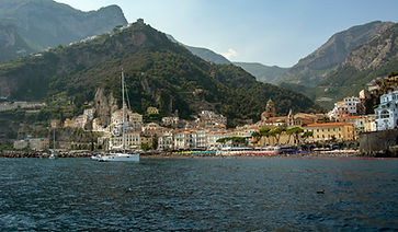 Luxury yacht cruising along the Amalfi Coast, near Positano, Italy