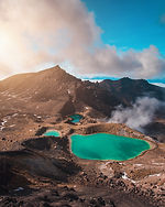 Guided hike of the Tongariro Crossing in New Zealand, along gothermal lakes.