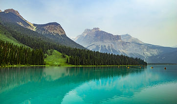 Guided kayaking tour of the Emerald Lake in Banff National Park, Canada.