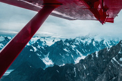 Flying over Denali mountain peaks