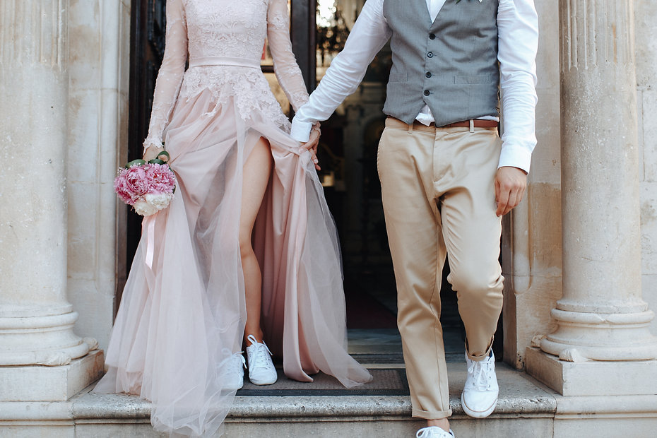 Stylish marriage couple get out of the c