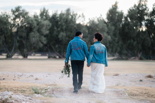 Bride and groom with denim jackets