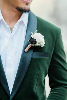 Wedding boutonniere with green velour jacket