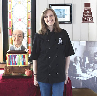 Rhianydd Webb of Dragons and Daffodils Cakes on Roald Dahl Day with a sculpted cake in the Norwegian church