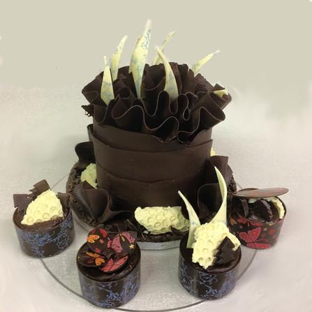 Chocolate ruffle wrap cake and matcing pots £100 plus £12 ea
