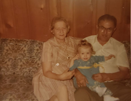 Bill and Jean Herhold with granddaughter