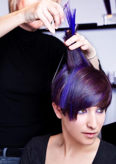 Lady having her hair cut