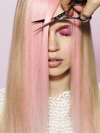 Pink haired woman having haircut