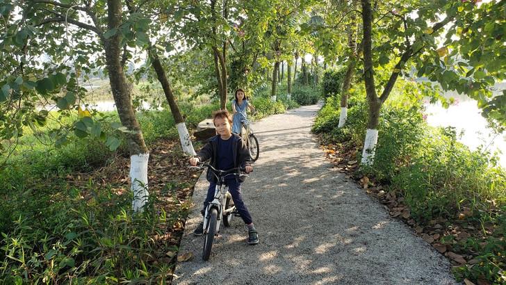 Kids riding bikes at Hanoi Ecopark.