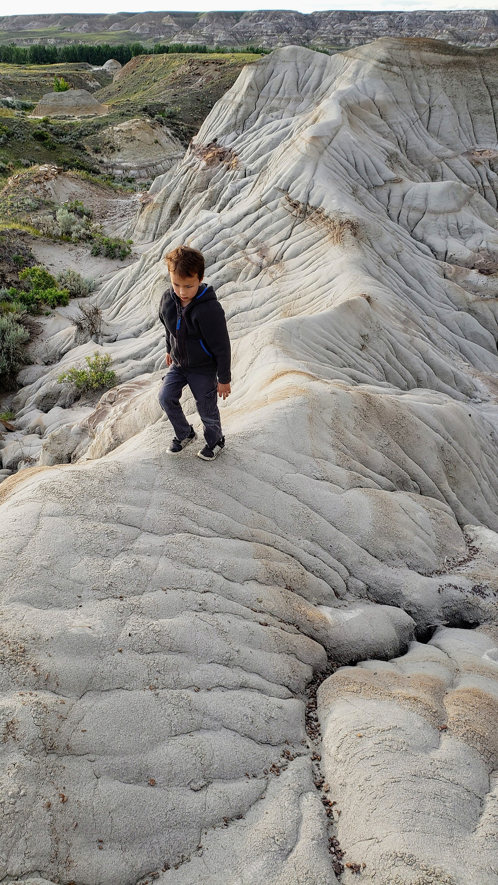 Hiking in the badlands at sunset with kids, Dinosaur Provincial Park, Alberta