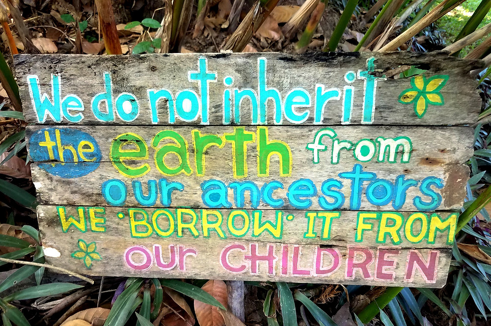 """We do not inherit the earth from our ancestors, we borrow it from our children"" sign"