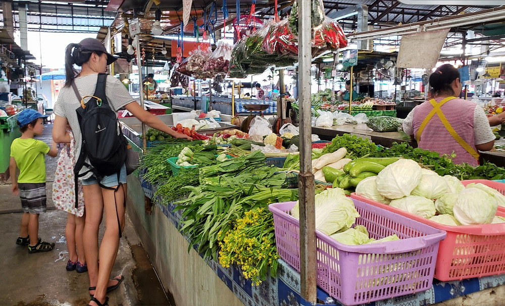 Buying fresh local produce at the market in Chiang Mai, Thailand