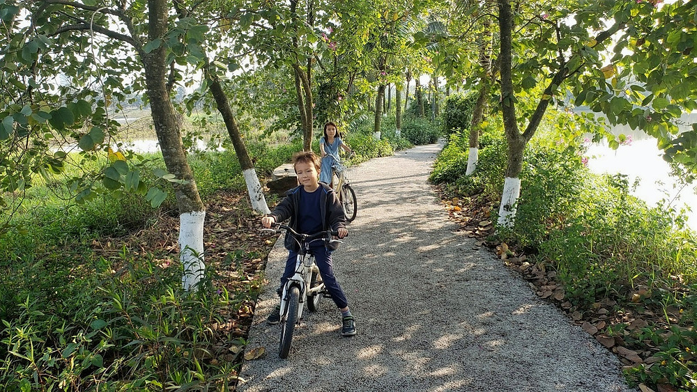 Kids riding bikes in Hanoi Ecopark
