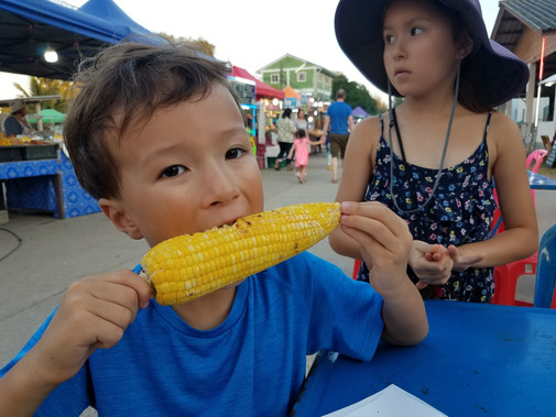 Enjoying grilled corn on the cob at the night market