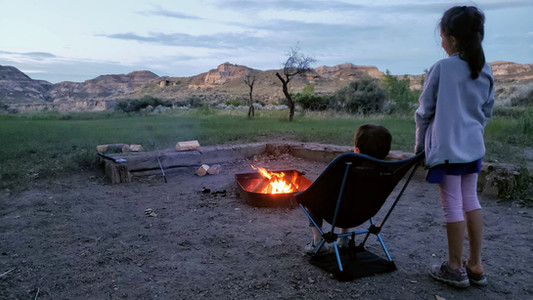 Campfire at sunset with kids, Dinosaur Provincial Park