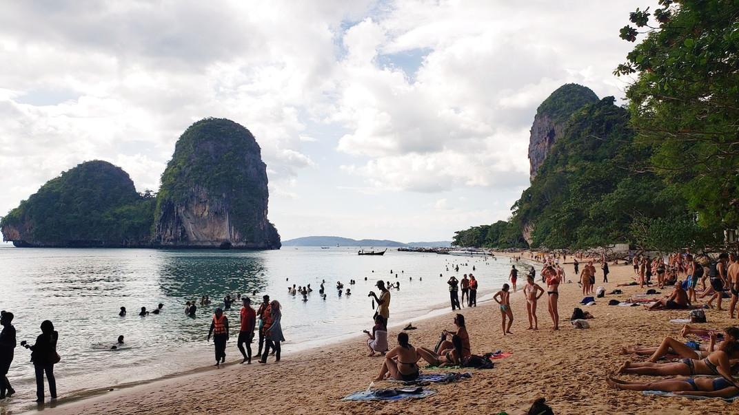 Busy beach scene in Phra Nang beach, Krabi, Thailand