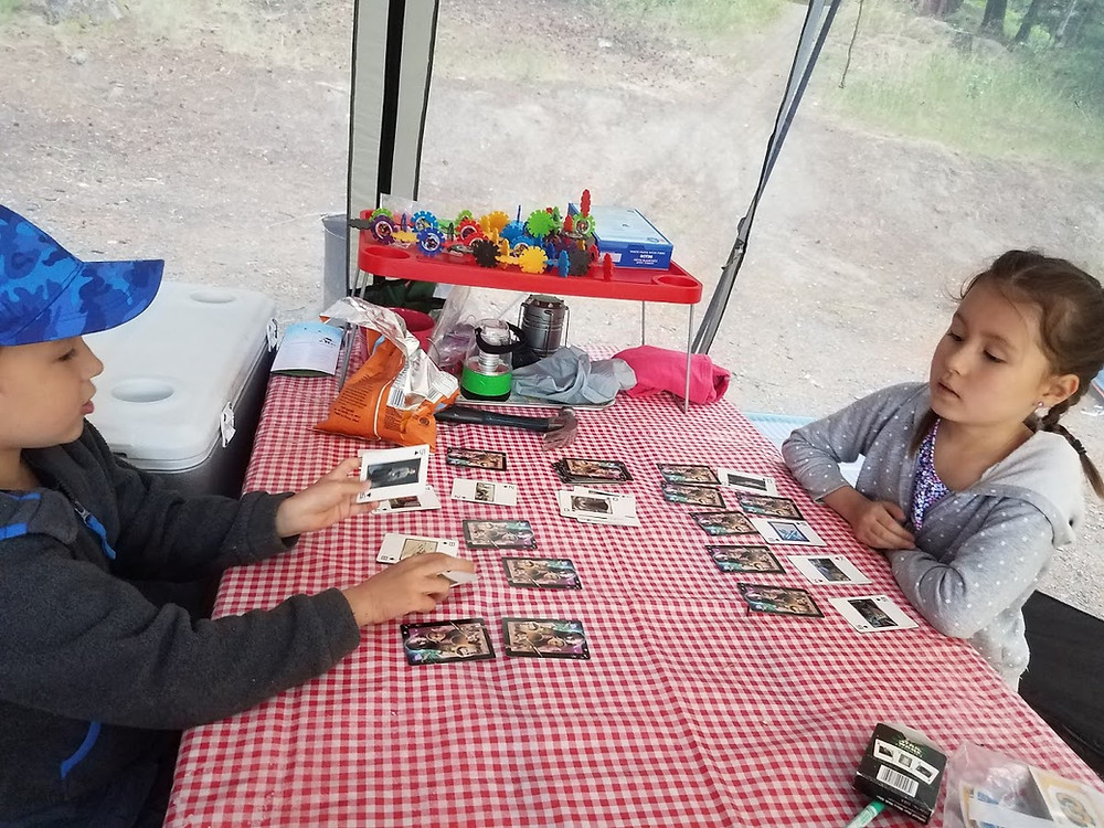 Kids playing cards while camping