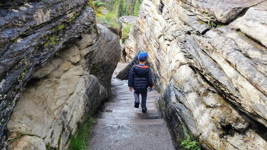 Kids exploring Athabasca falls, Jasper National Park