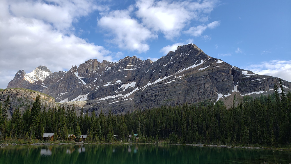 Cabins with mountain backdrop at Lake O'hara, Yoho National Park, B.C.