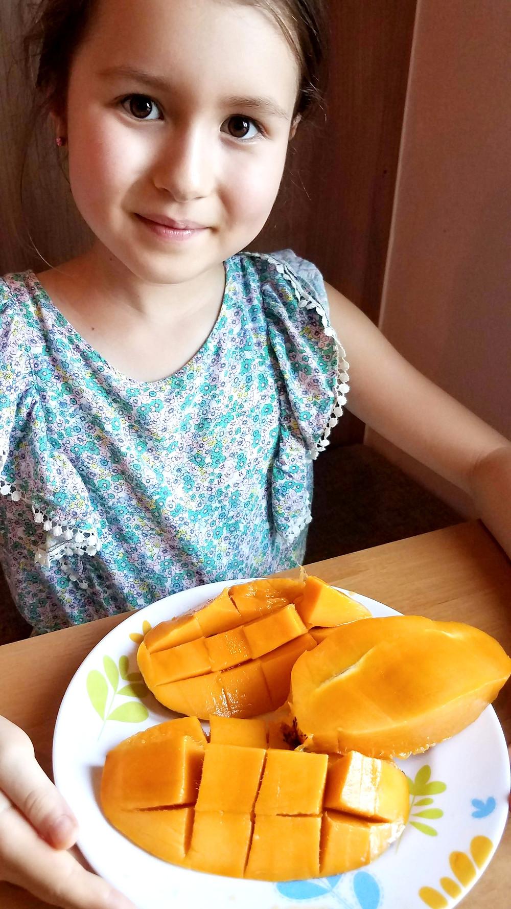 Mango loving kid