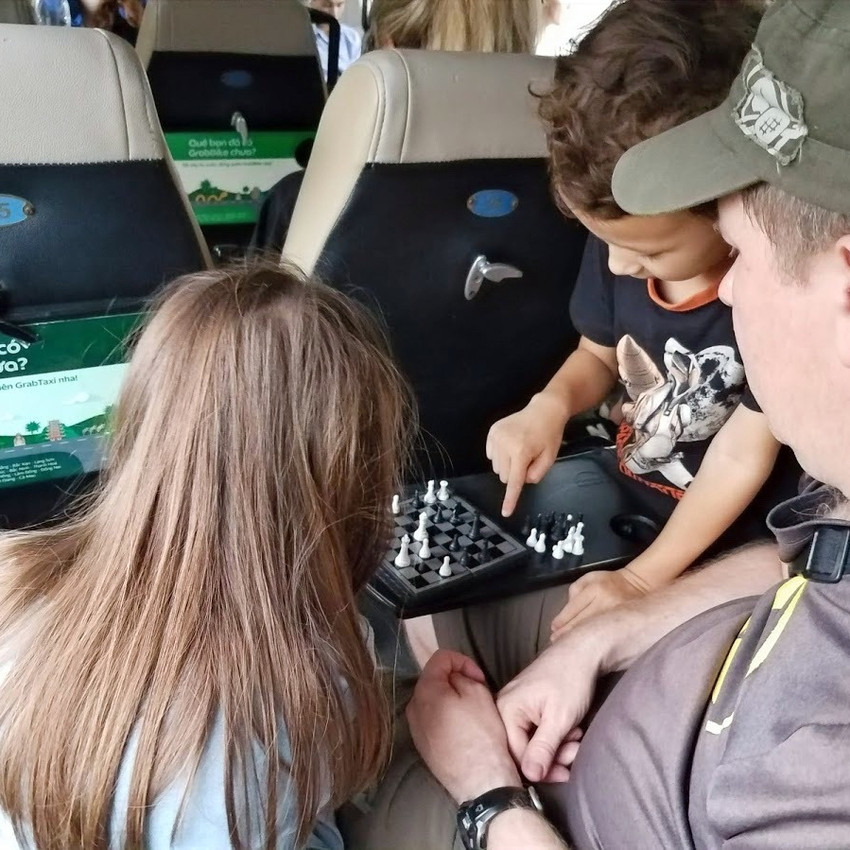 Playing chess during the train ride to Ninh Binh