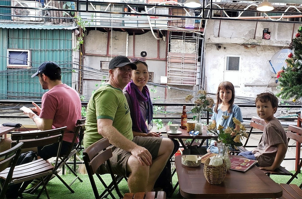 At a cafe in Hanoi, enjoying the Train Street below