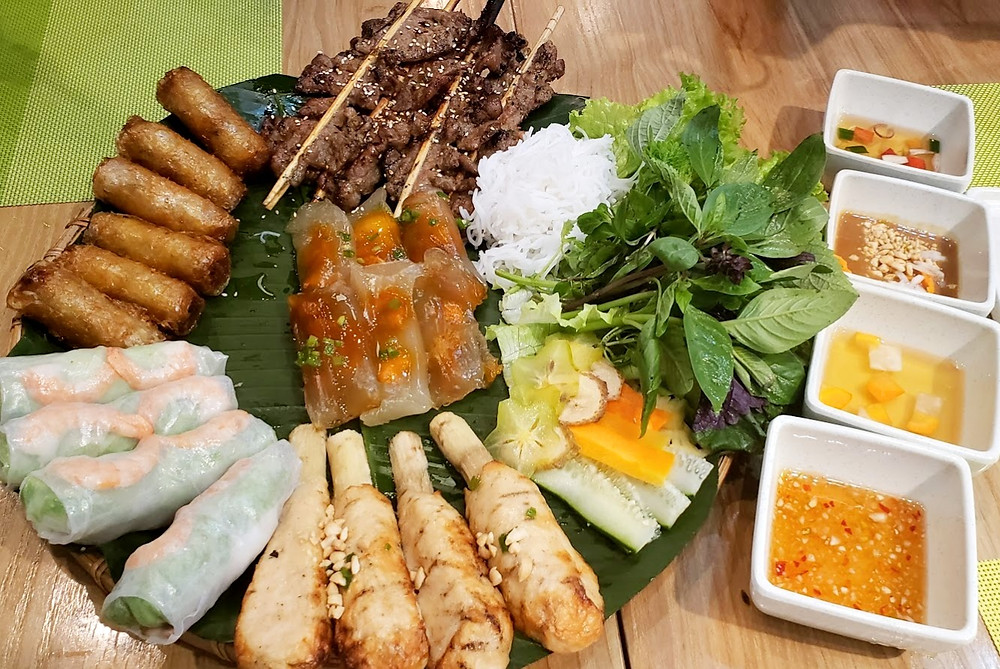 Platter of vietnamese food with sauces