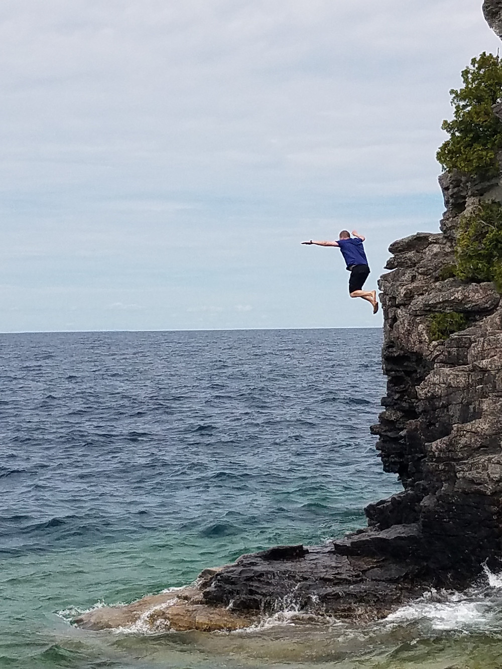 Cliff jumping in the chilly waters of Tobermory, Ontario