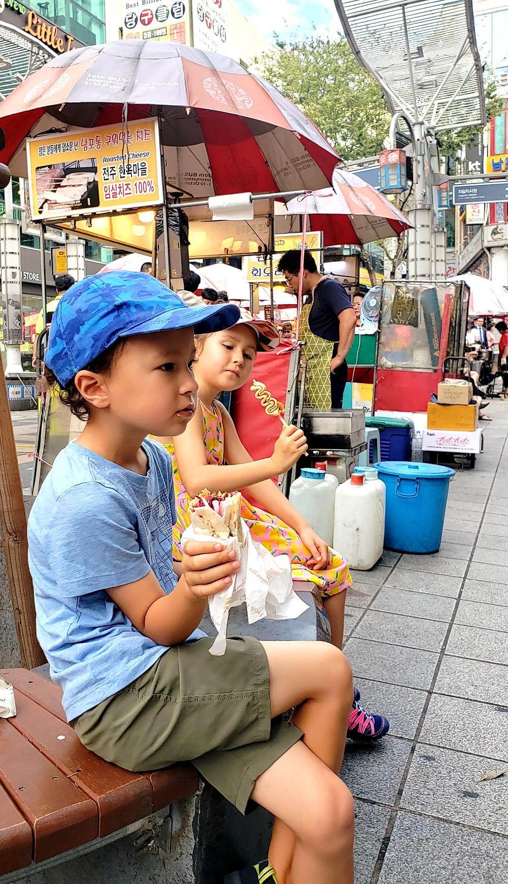 Kids eating street food