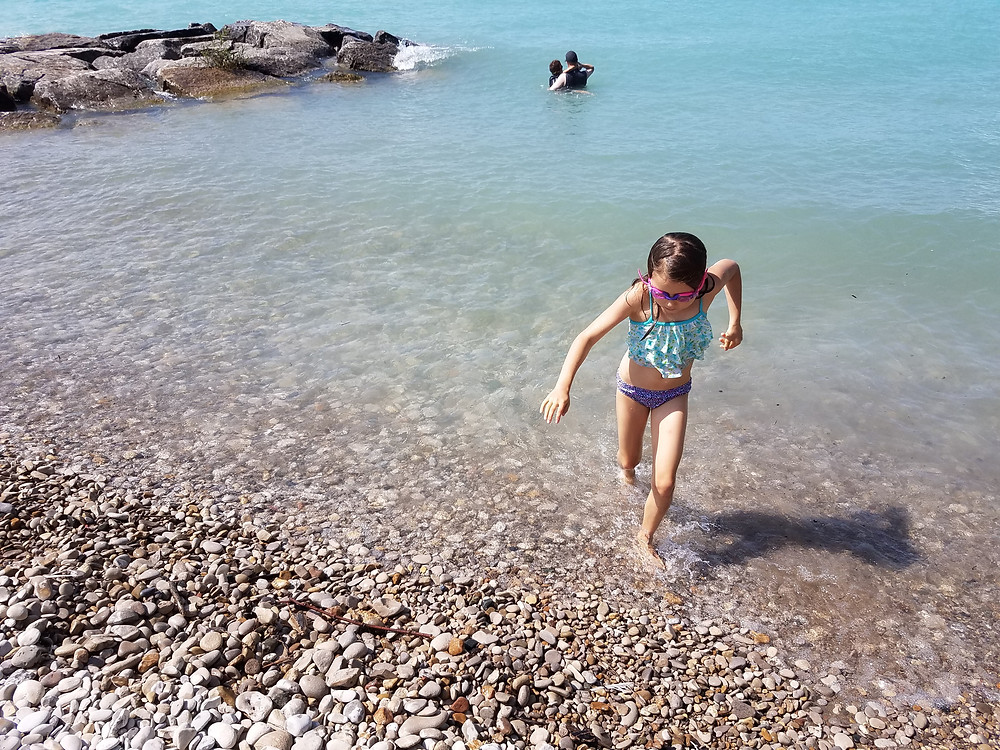 Kids swimming in the cold waters of Lake Huron, Goderich, Ontario