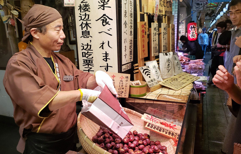Selling chestnuts at Nishiki Market, Kyoto, Japan