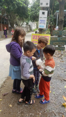 Kids playing with a puppy in Ninh Binh