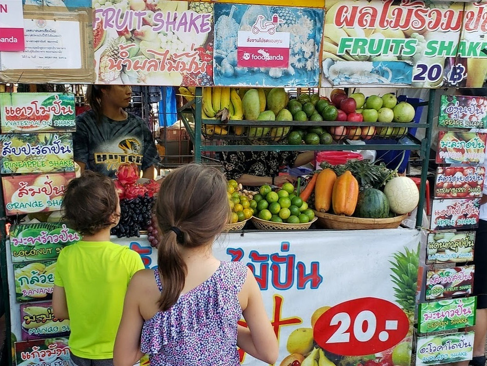 The kids deciding on which flavour at a cheap fruit shake stand in Chiang Mai