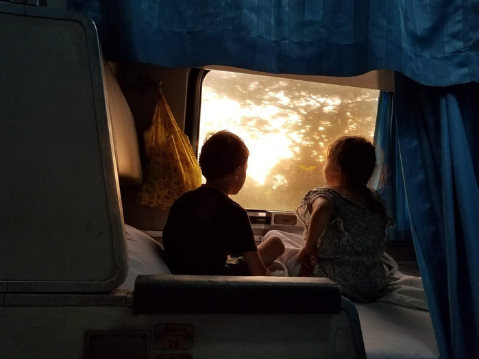 Watching the sunrise on the train in Thailand
