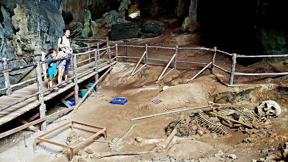 Art installation of giant skeleton and serpent, in Khap Khanap Cave